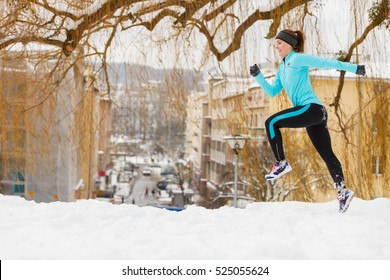 Girl exercising in city. Winter sports, outdoor fitness, fashion, urban workout, health concept.