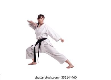 girl exercising karate, against white background