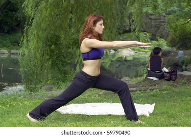Girl exercising in park.