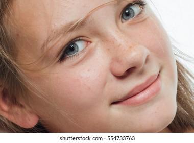Girl face closeup eyes freckles lips