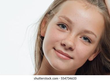Girl face closeup eyes freckles lips - Shutterstock ID 554734633