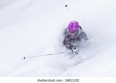 Girl falling on skis in the powder snow