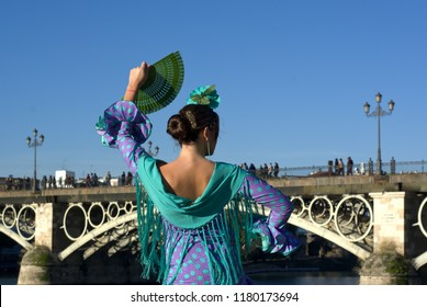 the girl with the fan and the flamenco dress