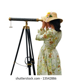 Girl in fancy dress and hat looking through telescope - isolated.