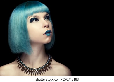 Girl with fashion blue hair over black background. Studio shooting. Art fashion and make up
