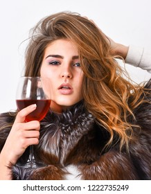 Girl fashion makeup wear fur coat hold glass alcohol. Elite leisure. Reasons drink red wine in wintertime. Lady fashion model curly hairstyle enjoy elite wine. Wine culture concept. Woman drink wine.