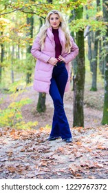 Girl fashionable blonde walk in park. Jackets everyone should have. Best puffer coats to buy. How to rock puffer jacket like star. Puffer fashion concept. Outfit prove puffer coat can look stylish.