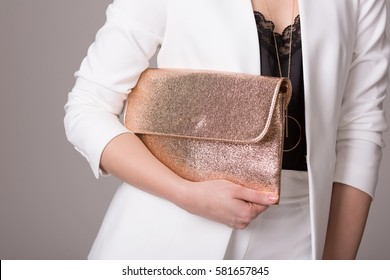Girl in fashionable clothes holding pink handbag. Elegant outfit. Female fashion.