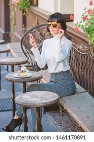 Girl fashionable lady with smartphone. Pleasant time and leisure. Relax and coffee break. Woman attractive elegant brunette spend leisure cafe terrace background. Call friend. Leisure concept.