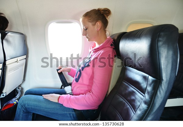 Girl fastening her seat belt