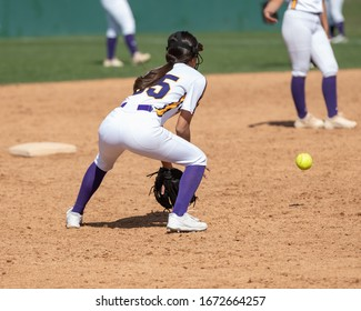 Girl Fastpitch Softball player in action during a competitive game