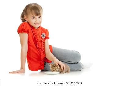 Girl feeding homeless alley cat