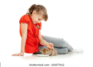 Girl feeding homeless alley cat