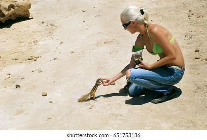 girl feeding a squirrel