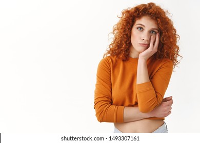 Girl feeling fatigue of working. Indifferent and reluctant redhead female student look unbothered and uninterested participating boring university event, facepalm look camera unamused and tired
