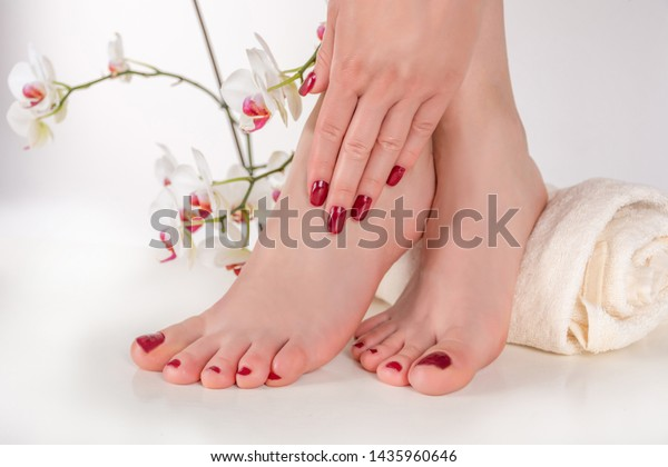 girl-feet-burgundy-color-pedicure-600w-1