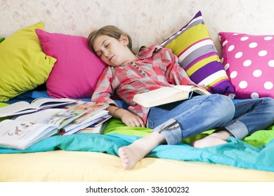 girl fell asleep while reading a book