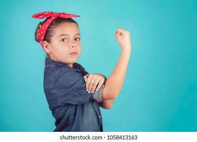 girl feminism,girl showing her muscular arm