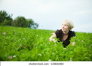 Girl in a field of flowers smiling