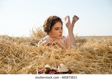 girl in a field on the Seine