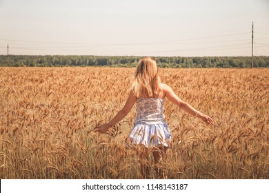 girl in the field of a rye, haystacks, a haymaking