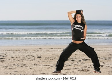 girl fighting in a the beach