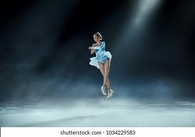 girl figure skating at ice arena