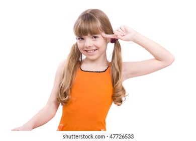 Girl with finger near her head.  Girl in glasses playing the fool.