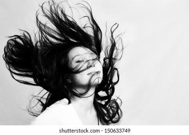 Girl flicking her hair in studio