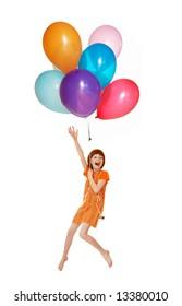The girl flies on balloons