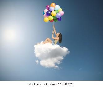 Girl flies over a soft cloud
