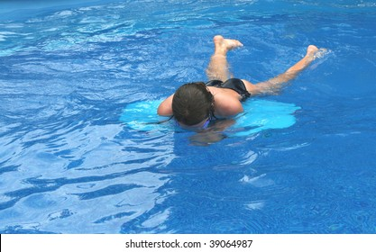 Girl floating on a board in the water
