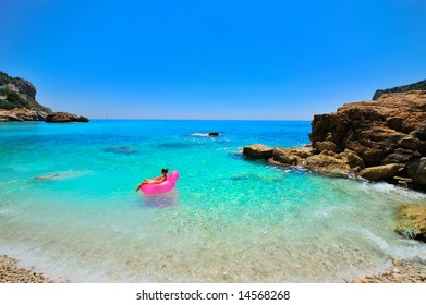 girl floating on turquoise water