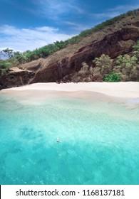 Girl floating in the turquoise ocean. Maui - Hawaii, Big Beach makena