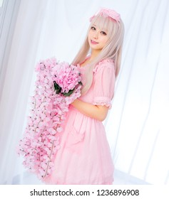 Girl with flowers pink lolita dress japanese style