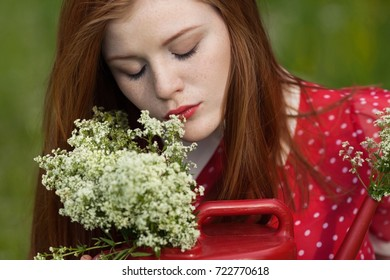 girl with flowers, watering