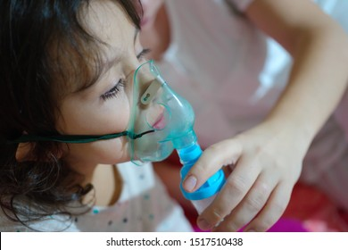 the girl with the flu, upper respiratory infection. being treated with nebulizer. virus, epidemic and infectious disease treatment
