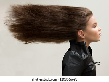 A girl with fluttering hair. Natural, healthy, creative.