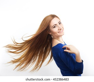 Girl with flying hair.Young smiling girl with long healthy hair. Healthy strong hair. Strong hair. Beautiful slim girl with a haircut. Hair style