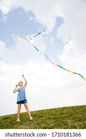 girl flying kite on a nice day