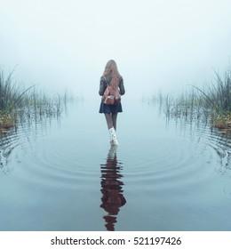 girl in the fog in the lake