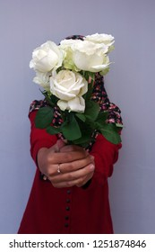 Girl with folwer bouquet in hand
