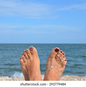 Girl foot  on the background of the sea