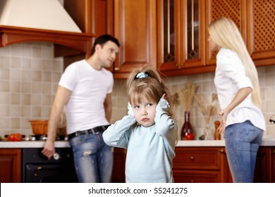 The girl in the foreground at quarrel of parents