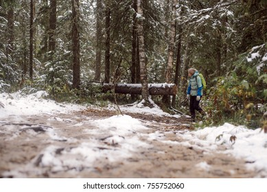 The girl in the forest with the backpack at the winter