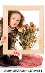 girl with a frame and a still life of flowers
