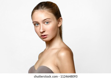 Girl with freckles beaty studio portrait, Young female fresh healthy skin, skincare and cosmetology concept, rejuvenation and treatment