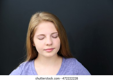 girl with freckles with eyes closed