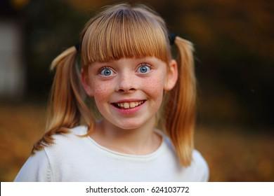 girl in freckles happy