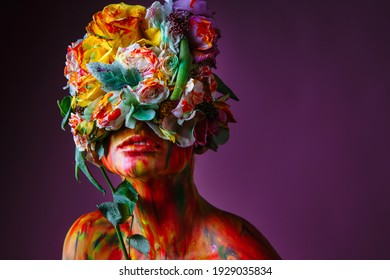A girl with fresh flowers on her head. Flower Man